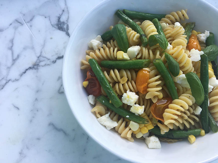 Pasta with fresh green beans corn and basil
